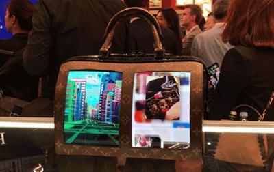 """LV三款""""黑科技""""包包进博会首秀:自带屏幕 可变色、可播放视频"""